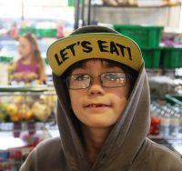 RIBBON CUTTING CEREMONY COFB Pic of boy with  LETS EAT Hat (1).JPG